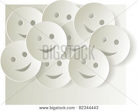 Paper cut out smiley faces on light background