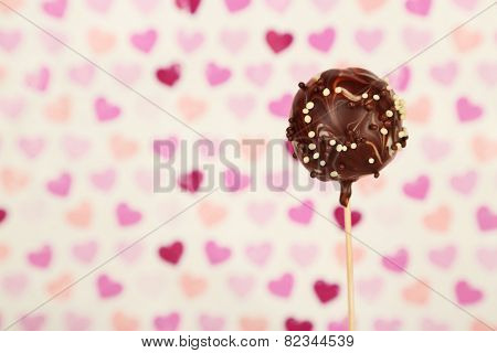 Tasty cake pop on color background