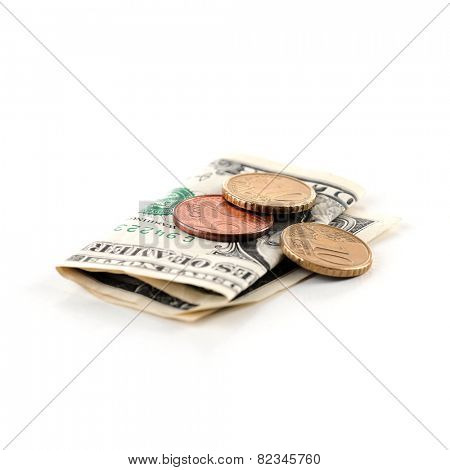 Paper money and coins isolated on white