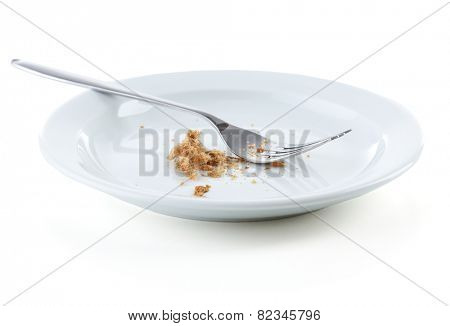 Bread crumbs on plate with fork isolated on white