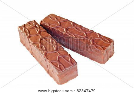 Mini Chocolate Cakes Covered With Fudge Sauce, White Background