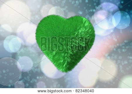 Green fuzzy heart against light glowing dots on blue