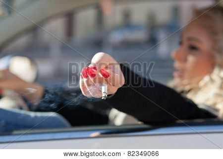 Cigarette Smoke By A Woman In Her Car