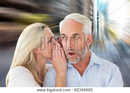 Woman whispering a secret to husband against new york street