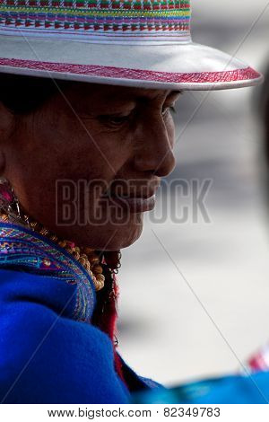 Portrait of indigenous woman from Guaranda Ecuador wearing traditional clothing