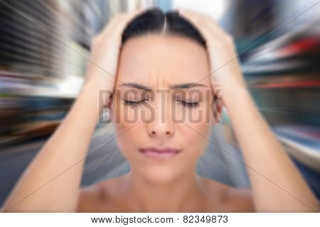 Woman with headache against blurry new york street