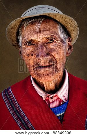 Portrait of indigenous old man from Guaranda Ecuador wearing traditional clothing