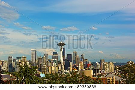 Seattle city skyline with Mount Rainier on background in summer.