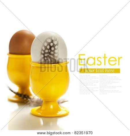 eggs  in yellow eggcups  isolated on white