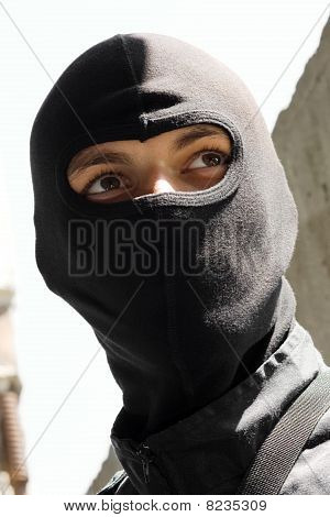 Portrait Of A Soldier In Black Mask