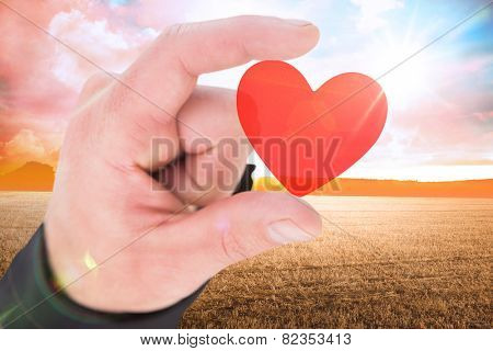 Businessmans fingers presenting against countryside scene
