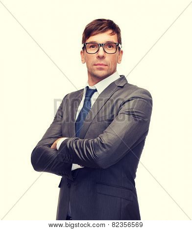 business and office concept - attractive buisnessman or teacher in glasses