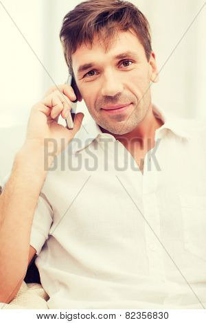 business, communication, modern technology concept - buisnessman with cell phone