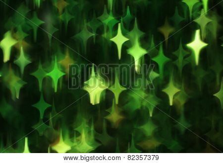 Abstract dark background with green stars