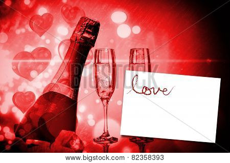 Love spelled out in petals against white card
