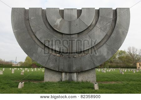 TEREZIN, CZECH REPUBLIC - APRIL 11, 2014: Menorah Monument at the Jewish Cemetery, where Jewish victims of the Ghetto Terezin are buried in Terezin, Czech Republic.