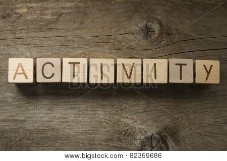 activity word on a wooden background