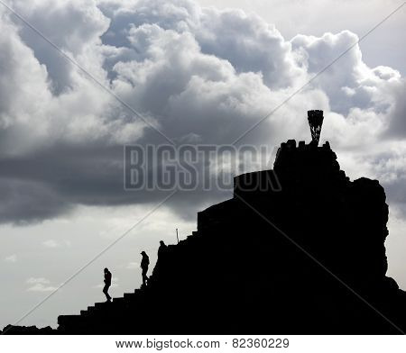 Man descending the falaise ofSan Sebastian de la Gomera, Canary Islands, Spain