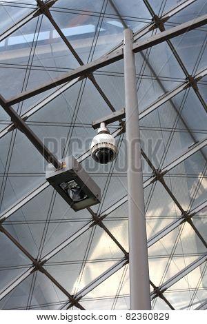 Camera Operating On Train Station Platform
