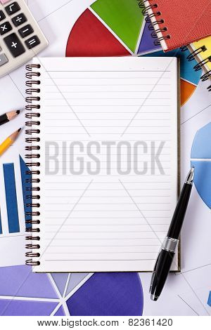 Financial Background With Blank Notepad