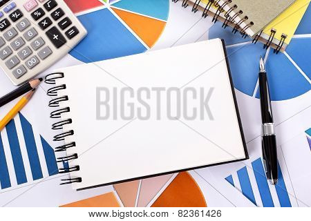 Financial Background With Blank Notebook
