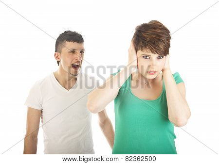 Young Man Shouting At Young Woman Isolated On White Background
