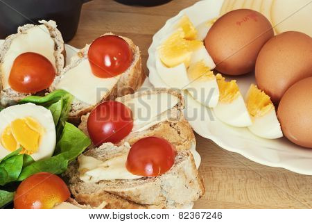Bread With Eggs, Cherry Tomatoes And Green Lettuce