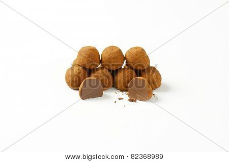 belgian pralines with chocolate butter on white background