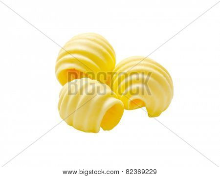 Curls of fresh butter isolated on white