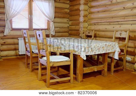 Interior of the dining room in the wooden house