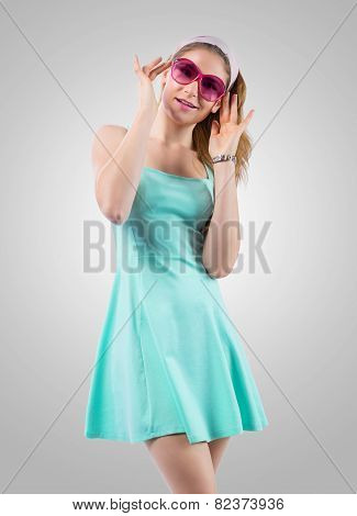 Smiling young woman looking through rose-coloured spectacles