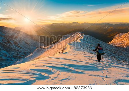 A Man In Mountain Sunset Winter