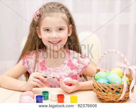 Cute Little Girl Painting Colorful Easter Eggs