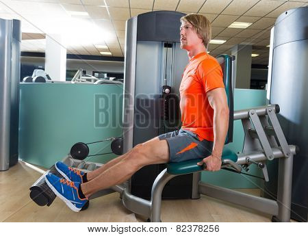 Calf extension blond man at gym exercise machine workout indoor