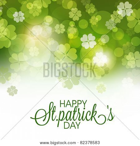 Happy St. Patrick's Day celebration greeting or invitation card decorated by shiny shamrock leaves.