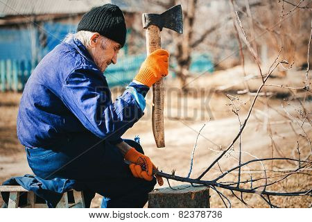 Grandfather Working With Axe In Blue Workwear