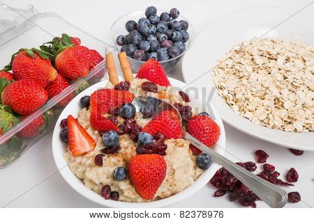 Oatmeal With Blueberries Strawberries Cranberries And Cinnamon With Spoon