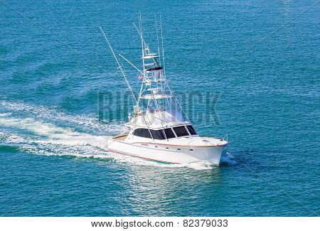 White Cabin Cruiser Over Blue Water