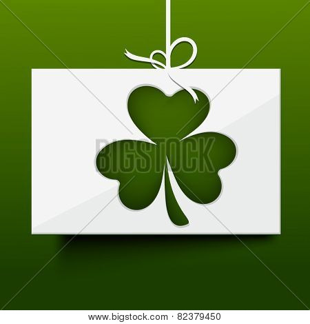 Irish lucky clover leaf on a glossy hanging card for Happy St. Patrick's Day celebration.