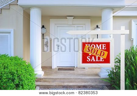 Sold home for sale Real estate sign in front of new house