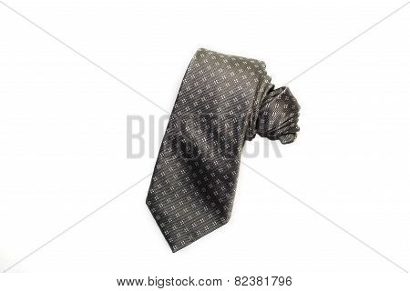 Folded Grey  Tie On A White Background