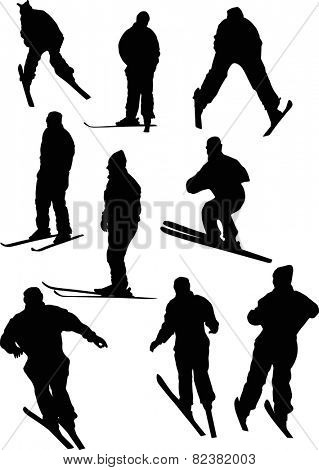 illustration with nine black skier silhouettes isolated on white background