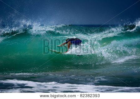 Surfer riding in the barrel. Midigama spot, Sri Lanka.