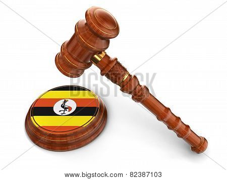 Wooden Mallet and Uganda flag (clipping path included)
