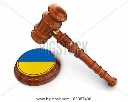 Wooden Mallet and Ukrainian flag (clipping path included)