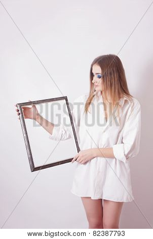 Sad Woman Holding A Frame In His Hands
