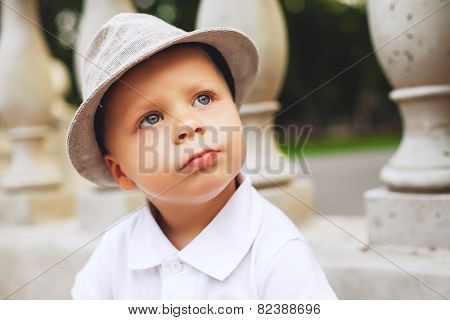 Cute Serious Boy In Hat