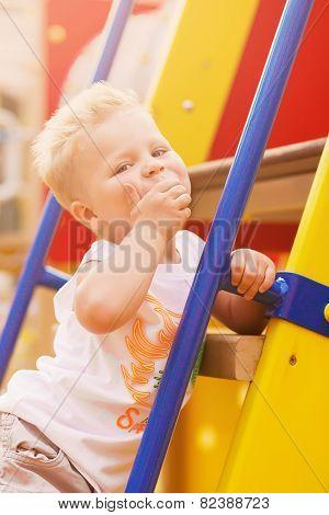 Funny Cute Boy On Playground