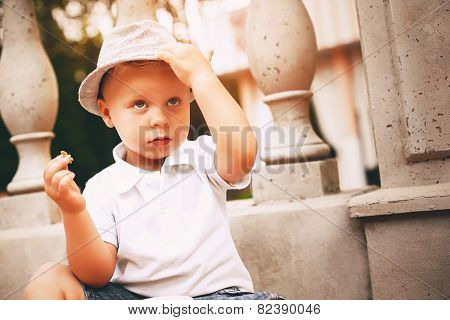 Little Boy Touching His Hat