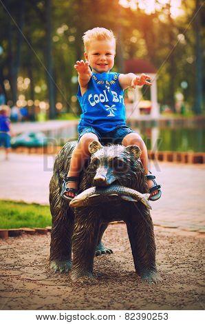 Smiling Boy Sitting On Bear